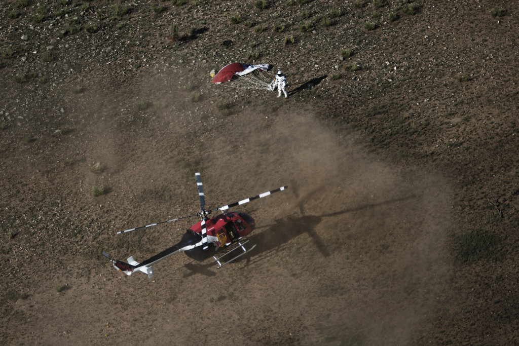 Pilot Felix Baumgartner of Austria lands in the desert during the second manned test flight for Red Bull Stratos in Roswell, New Mexico, USA on July 25, 2012. Red Bull Stratos is a mission to the edge of space to an altitude of 37.000 meters to break several records including the sound of speed in freefall.