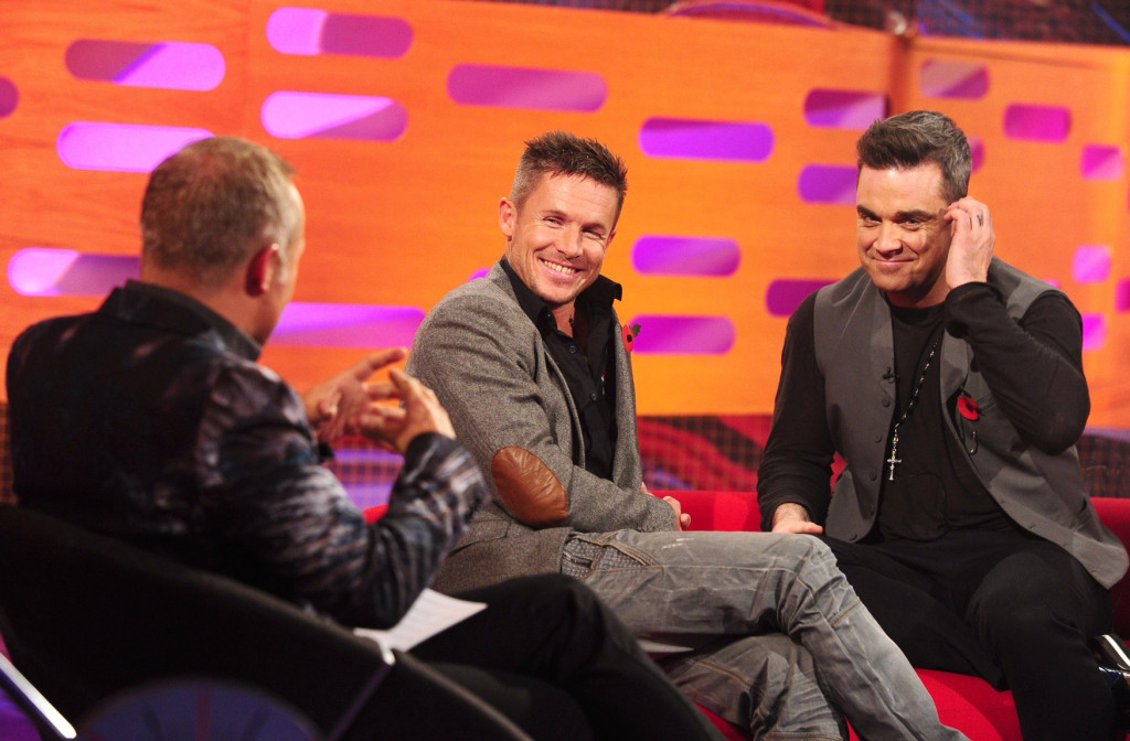 Graham Norton, Felix Baumgartner and Robbie Williams are seen on the Graham Norton show, filmed at the London studios in London . PRESS ASSOCIATION Photo. Picture date: Thursday 1st November, 2012. Photo credit should read: Ian West/PA Wire
